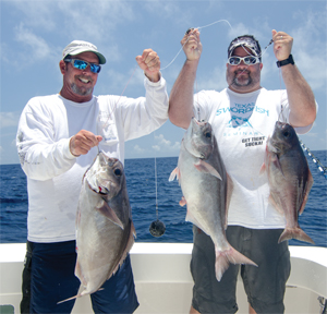 Capt. Jeff Wilson and Mike Parsons with a trio of barrelfish.