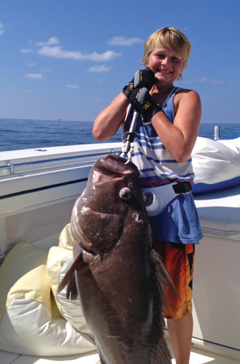 Cole Ruszkowski with a nice warsaw grouper caught in the Gulf of Mexico.
