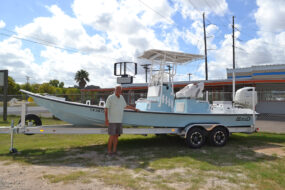 robbie with boat 285x190 Mowdy Boats